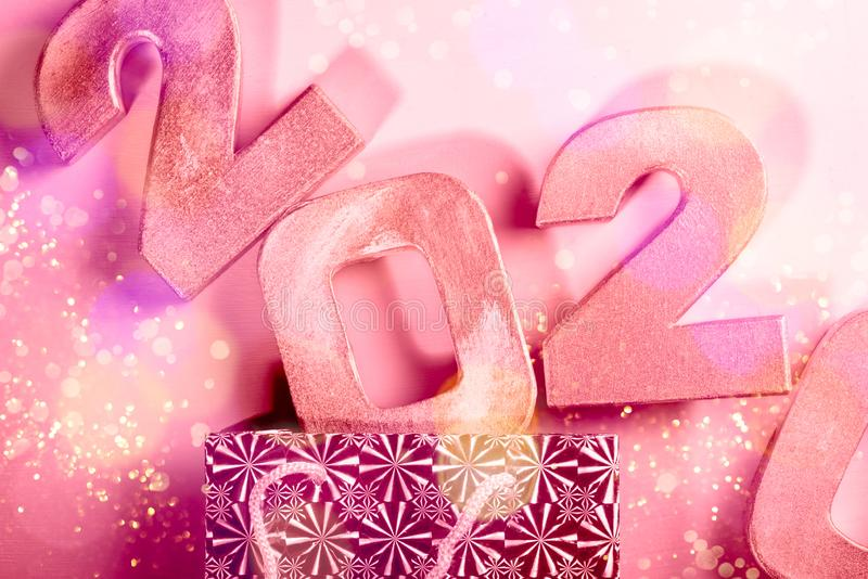 Happy New Year 2020. Digits 2020 are popping from the present bag. Holiday Party Decoration or postcard concept with top view and copy space royalty free stock photography