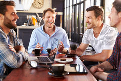 Men talking at a coffee shop Royalty Free Stock Photography