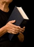 Old woman holding bible