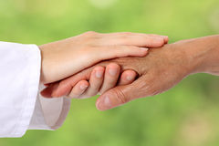 Woman hand helping senior in nature Royalty Free Stock Photography